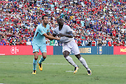 Barcelona Sergio Busquets and Manchester United Forward Romelu Lukaku during the International Champions Cup match between Barcelona and Manchester United at FedEx Field, Landover, United States on 26 July 2017.