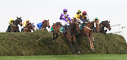 LIVERPOOL, ENGLAND - Friday, April 9, 2010: Always Wining ridden by Brian Hughes jumps the Chair during the second day of the Grand National Festival at Aintree Racecourse. (Pic by David Rawcliffe/Propaganda)