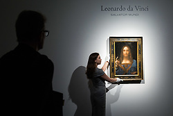 London, October 24 2017. A gallery assistant straightens Leonardo da Vinci's Salvator Mundi ('Saviour of the World') at a gallery preview at Christie's in London. The painting sold at Christie's in New York on 15 November 2017 for $450.3 million at Christie's New York, the highest price for any work of art. The painting is one of fewer than 20 known paintings by Leonardo, and the only one in private hands. © Paul Davey