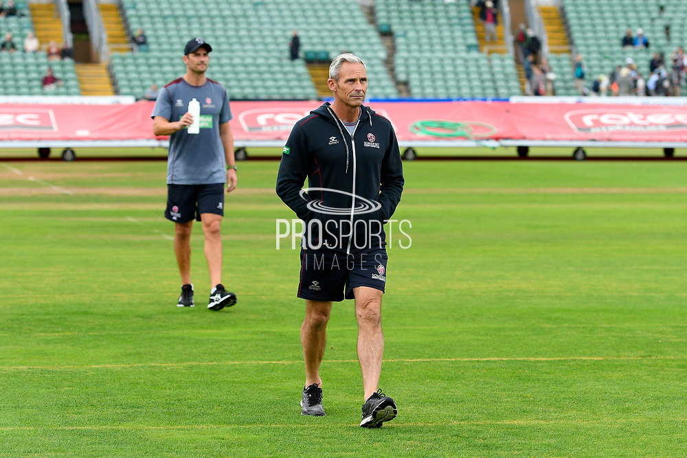 Somerset director of cricket Andy Hurry waks off the outfield as play is abandoned for the day due to a wet outfield from heavy overnight rain during the Specsavers County Champ Div 1 match between Somerset County Cricket Club and Essex County Cricket Club at the Cooper Associates County Ground, Taunton, United Kingdom on 25 September 2019.