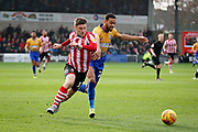Lincoln City Shay McCartan(17) gets behind the Mansfield defence during the EFL Sky Bet League 2 match between Lincoln City and Mansfield Town at Sincil Bank, Lincoln, United Kingdom on 24 November 2018.