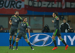 VIENNA, AUSTRIA - Thursday, October 6, 2016:  Wales' Joe Allen is congratulated by Joe Ledley and Gareth Bale after scoring the opening goal against Austria during the 2018 FIFA World Cup Qualifying Group D match at the Ernst-Happel-Stadion. (Pic by Peter Powell/Propaganda)