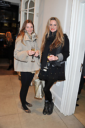 Left to right, sisters SUZIE DANIELS and BRYONY DANIELS at a party to celebrate the switching on of the Christmas Lights at the Stella McCartney store, Bruton Street, London on 29th November 2011.