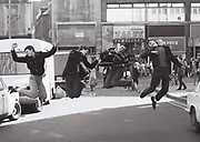 Teenagers jumping, Oxford St, London, UK, 1981