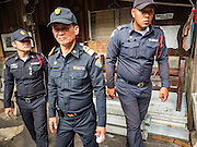 03 SEPTEMBER 2016 - BANGKOK, THAILAND: Bangkok code enforcement officers in the Pom Mahakan community during a city operation to evict people from the community. Hundreds of people from the Pom Mahakan community and other communities in Bangkok barricaded themselves in the Pom Mahakan Fort to prevent Bangkok officials from tearing down the homes in the community Saturday. The city had issued eviction notices and said they would reclaim the land in the historic fort from the community. People prevented the city workers from getting into the fort. After negotiations with community leaders, Bangkok officials were allowed to tear down 12 homes that had either been abandoned or whose owners had agreed to move. The remaining 44 families who live in the fort have vowed to stay.      PHOTO BY JACK KURTZ