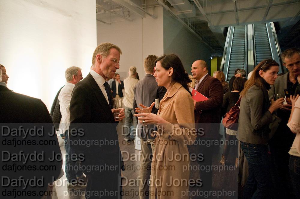 SIR NICHOLAS SEROTA; TARYN SIMON;, A Living man declared Dead and Other Chapters. Taryn Simon. Tate Modern, London. 24 May 2011. <br /> <br />  , -DO NOT ARCHIVE-© Copyright Photograph by Dafydd Jones. 248 Clapham Rd. London SW9 0PZ. Tel 0207 820 0771. www.dafjones.com.