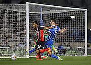 AFC Bournemouth striker Callum Wilson evades a tackle from Brighton's Lewis Dunk during the Sky Bet Championship match between Brighton and Hove Albion and Bournemouth at the American Express Community Stadium, Brighton and Hove, England on 10 April 2015. Photo by Phil Duncan.