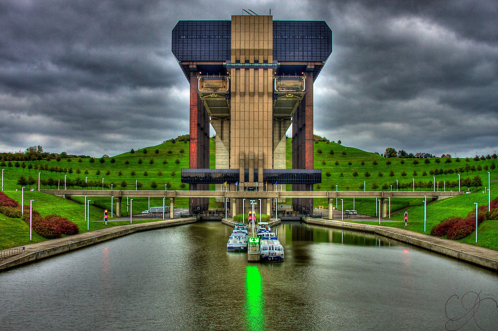 Since Belgium has no natural rivers, man-made canals were dug to provide commercial shipping - since the terrain is not flat, you need a system of locks to allow transport: Enter the Ascenseur de Strepy-Thieu: The world's largest lock/boat lift at 240 feet (73.15 M)