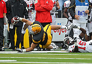 September 25 2010: Iowa Hawkeyes tight end Allen Reisner (82) dives for extra yards as he is tripped up by Ball State Cardinals cornerback Aaron Morris (15) during the first half of the NCAA football game between the Ball State Cardinals and the Iowa Hawkeyes at Kinnick Stadium in Iowa City, Iowa on Saturday September 25, 2010. Iowa defeated Ball State 45-0.