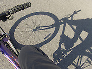 shadow of bicycle on asphalt