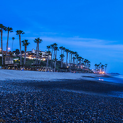 San Clemente CA beach at night panorama photo in blue. San Clemente is a popular coastal beach city along the Pacific Ocean in Orange County Southern California. Panorama photo ratio is 1:3. Copyright ⓒ 2017 Paul Velgos with All Rights Reserved.