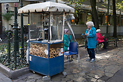 A Polish lady street kiosk snack seller talks to another woman,  on 23rd September 2019, in Krakow, Malopolska, Poland.