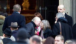© London News Pictures. 13/02/2014. London, UK. Actor David Jason being greeted by Roger Lloyd-Pack's wife  Jehane Markham (right, grey hair) at the church. Pictured in pink is Sue Holderness who played Marlene Boyce.  The funeral of actor Roger Lloyd-Pack at St Pauls Church also known as 'The Actor's Church'  in Covent Garden, London. Roger Lloyd-Pack was famous for playing roles such as Trigger in Only Fools and Horses and Owen Newitt in the The Vicar of Dibley. Photo credit : Ben Cawthra/LNP