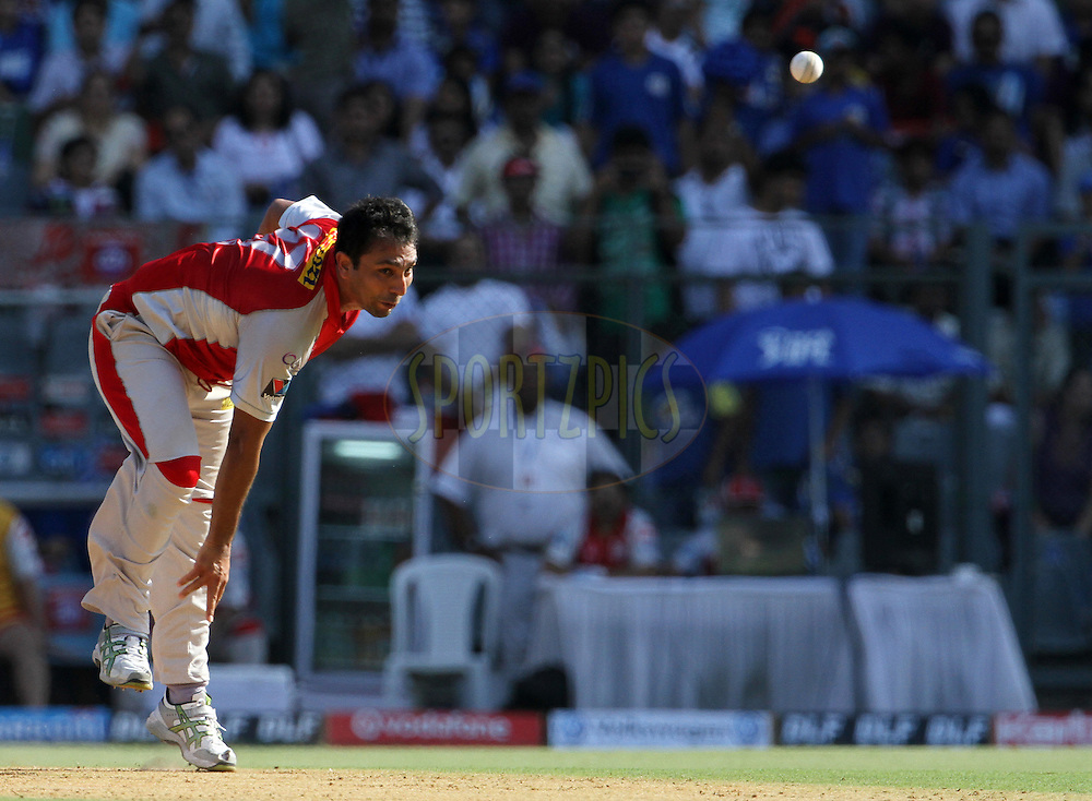 Kings XI Punjab player Azar Mahmood bowls during match 28 of the Indian Premier League ( IPL) 2012  between The Mumbai Indians and the Kings X1 Punjab held at the Wankhede Stadium in Mumbai on the 22nd April 2012..Photo by: Vipin Pawar/IPL/SPORTZPICS