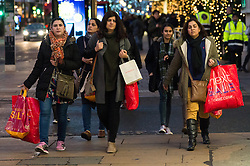 © Licensed to London News Pictures. 26/12/2016. Customers shopping in Oxford Street at the start of Boxing Day sales. London, UK. Photo credit: Ray Tang/LNP