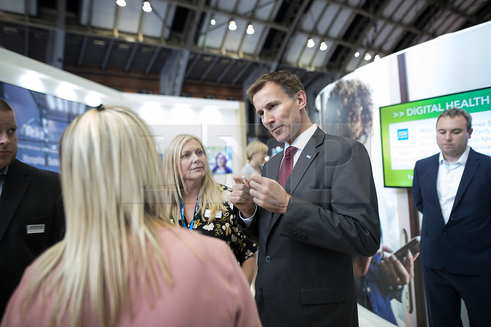 © Licensed to London News Pictures . 12/09/2017. Manchester , UK . Health Secretary JEREMY HUNT tours the Health and Care Innovation Expo at Manchester Central Convention Centre . Photo credit: Joel Goodman/LNP
