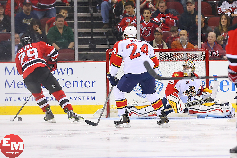 Mar 31, 2014; Newark, NJ, USA; New Jersey Devils left wing Ryane Clowe (29) scores a goal on Florida Panthers goalie Dan Ellis (39) during the second period at Prudential Center.