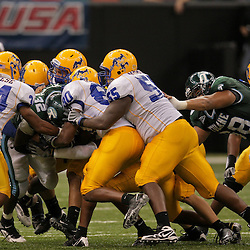 Sep 26, 2009; New Orleans, LA, USA;  McNesse State Cowboys defenders combine to tackle Tulane Green Wave running back Andre Anderson (32) at the Louisiana Superdome. Tulane defeated McNeese State 42-32. Mandatory Credit: Derick E. Hingle-US PRESSWIRE