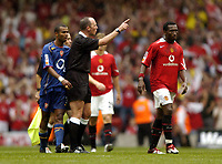 Photo: Richard Lane.Digitalsport<br /> Arsenal v Manchester United. FA Community Shield. 08/08/2004.<br /> Referee, Mike Dean tells Eric Djemba Djemba to leave the field after a post whistle argument.