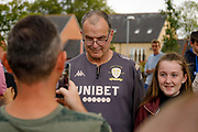 Leeds United Manager Marcelo Bielsa poses for a selfie  during the Pre-Season Friendly match between Guiseley  and Leeds United at Nethermoor Park, Guiseley, United Kingdom on 11 July 2019.