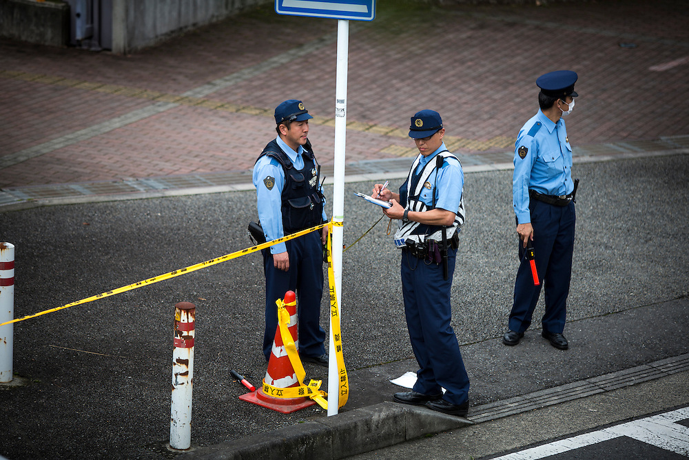 SAGAMIHARA, JAPAN - JULY 27 :  Police officers continue to investigate on knife attack in a handicap center in Tsukui Yamayuri-en building at Sagamihara on Wednesday, July 27, 2016 in Kanagawa prefecture, Japan. Police arrested 26 year old Satoshi Uematsu after breaking inside the building facility for handicapped and killing 19 people and injuring 20 in the city of Sagamihara, west of Tokyo. (Photo: Richard Atrero de Guzman/NURPhoto)