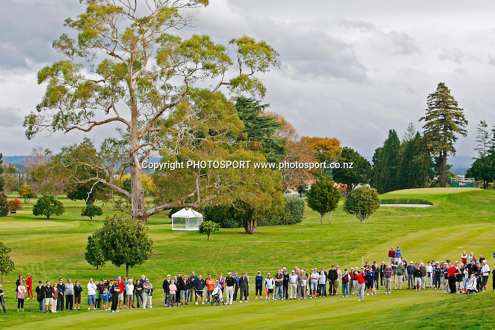 Hamish Robertson hits a shot infront of a group of spectators. The Charles Tour, 2009 Carrus Tauranga Open, Tauranga Golf Course, Tauranga, New Zealand. Sunday 17 May 2009. Photo: Anthony Au-Yeung/PHOTOSPORT