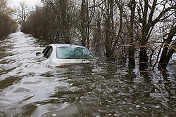 © London News Pictures. 20/03/14 A submerged car, which became the unofficial symbol of the Somerset floods, has apparently been sold for £101,100 on eBay. Hubert Zajaczkowski, 21, sold the Seat Toledo to raise money for a charity. FILE PICTURED DATED 31/01/2014. Muchelney, UK. A car trapped underneath flood water in Muchelney on Somerset Levels, where flood water has cut off parts of the community. Further wet weather at the weekend is due. Photo credit: Ed Stone/LNP