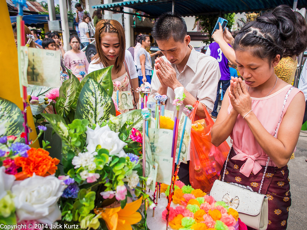 11 JULY 2014 - BANGKOK, THAILAND:   Thai Buddhists pray at Wat Mahabut for Asalha Puja Day. Asalha Puja is the day the Lord Buddha preached his first sermon to followers after attaining enlightenment. The day is usually celebrated by merit making and listening to a monks' sermons. It is also day before the start of the Rains Retreat, the three month period when monks stay in their temple for intense mediation and spiritual renewal.  PHOTO BY JACK KURTZ