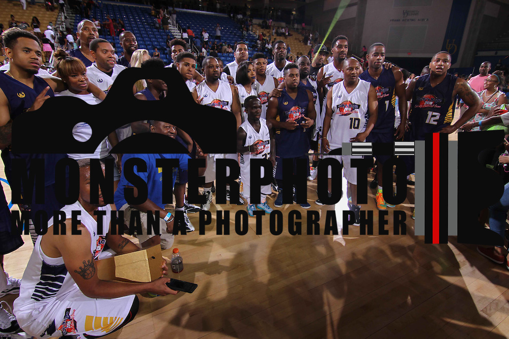 Participants pose a group photo after the conclusion of The 2015 Duffy's Hope Celebrity Basketball Game Saturday, August 01, 2015, at The Bob Carpenter Sports Convocation Center, in Newark, DEL.    <br /> <br /> Proceeds will benefit The Non-Profit Organization Duffy's Hope Youth Programming.