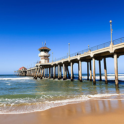 Photo of Huntington Beach Pier in Southern California. Huntington Beach Pier is a registered historic place located along the Pacific Ocean in Orange County California. Photo is high resolution and was taken in 2012.