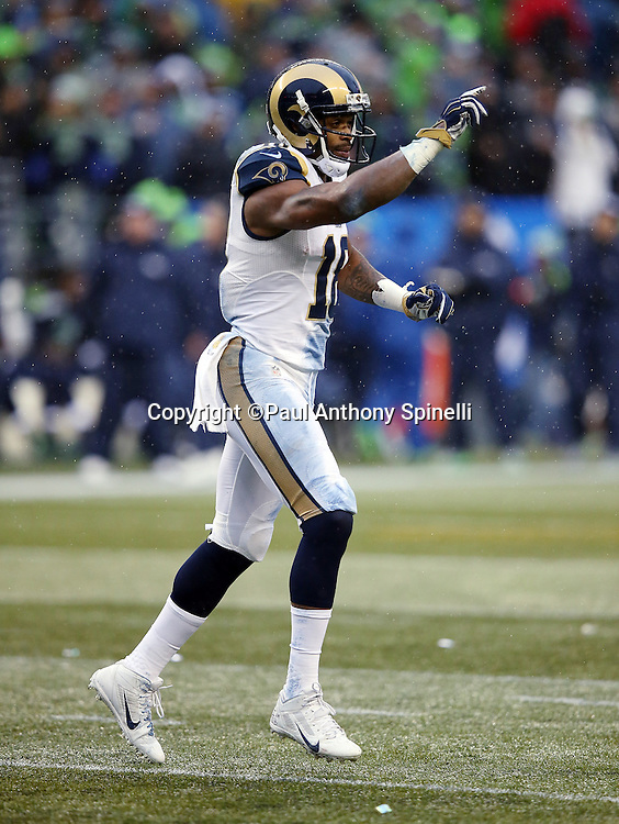St. Louis Rams wide receiver Kenny Britt (18) points during the 2015 NFL week 16 regular season football game against the Seattle Seahawks on Sunday, Dec. 27, 2015 in Seattle. The Rams won the game 23-17. (©Paul Anthony Spinelli)
