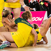 Picture by Christian Cooksey.Commonwealth Games Day 11 (3rd August 2014, The SECC Precinct.The  Hydro. Netball. Gold Medal Australia v New Zealand. Australian Goal Keeper and Captain Laura Geitz is piled on by her team mates