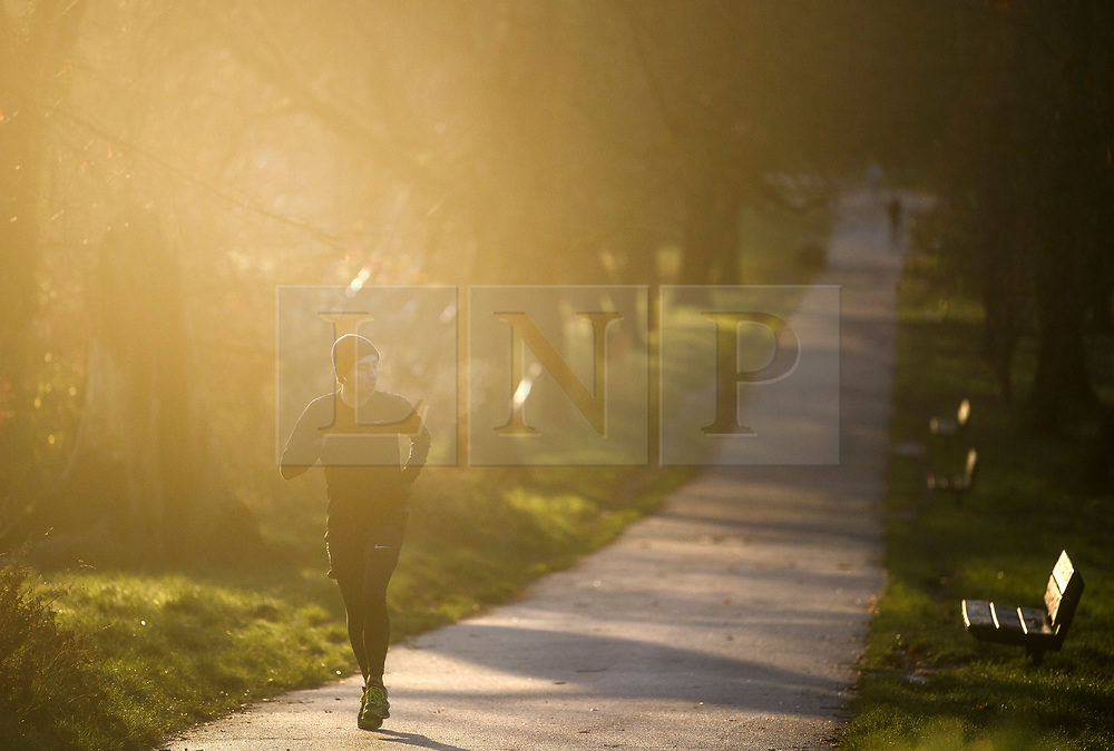 © Licensed to London News Pictures. 16/12/2018. London, UK. A man jogging at sunrise at Parliament hill on Hampstead Heath, on a cold winter morning.  Large parts of the UK have experienced snowfall as storm Deidre brings freezing temperatures. Photo credit: Ben Cawthra/LNP