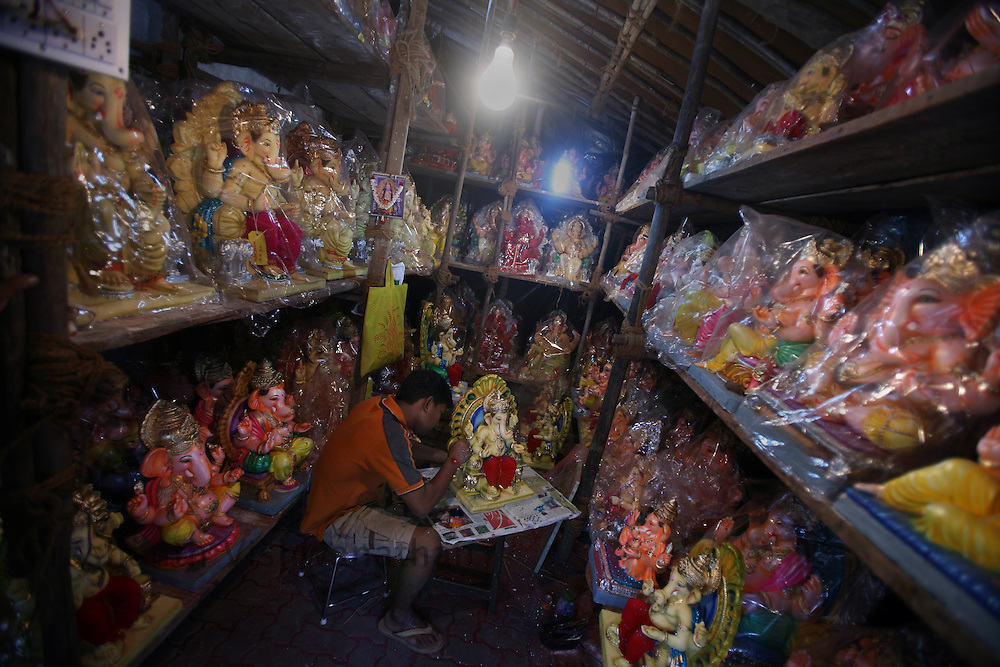 """Skilled labourer work on a unfinished Ganesha Idol in an workshop in Mumbai, September 6, 2007. Lord Ganesha idols are prepared for the """"Ganesh Chaturthi"""" (the Ganesh festival), a popular religious festival in India.Photographer: Prashanth Vishwanathan"""