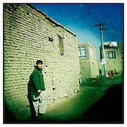 A boy in a narrow Kabul alley.