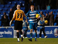 Photo: Daniel Hambury.<br />Reading v Brighton & Hove Albion. Coca Cola Championship. 10/12/2005.<br />Reading's hat trick hero David Kitson (R) shakes hands with Brighton's 'keeper Alan Blayney at the end of the match.