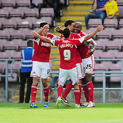 Bristol City's Marvin Elliott celebrates with his team mates after scoring. - Photo mandatory by-line: Dougie Allward/JMP - Tel: Mobile: 07966 386802 11/08/2013 - SPORT - FOOTBALL - Sixfields Stadium - Sixfields Stadium -  Coventry V Bristol City - Sky Bet League One