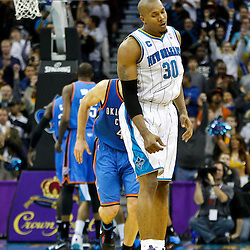 January 24,  2011; New Orleans, LA, USA; New Orleans Hornets power forward David West (30) reacts after scoring against the Oklahoma City Thunder during the fourth quarter at the New Orleans Arena. The Hornets defeated the Thunder 91-89. Mandatory Credit: Derick E. Hingle