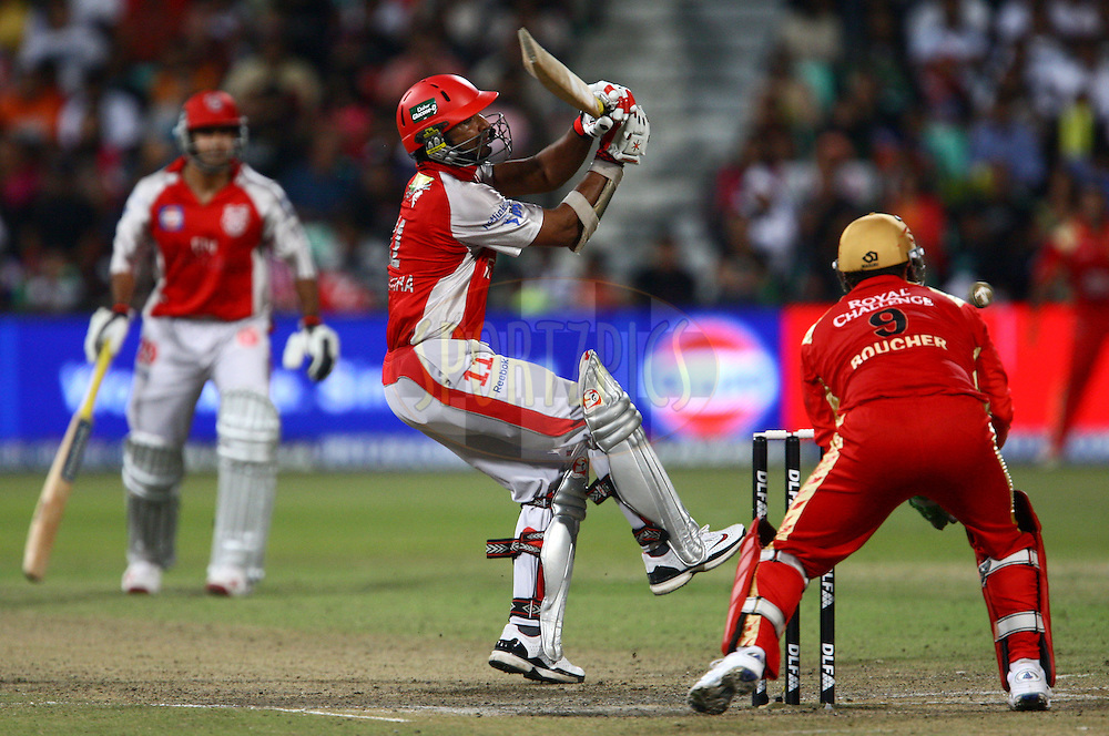 DURBAN, SOUTH AFRICA - 1 May 2009.Sangakkara puts this one away just past the gloves of Boucher during the IPL Season 2 match between Kings X1 Punjab and the Royal Challengers Bangalore held at Sahara Stadium Kingsmead, Durban, South Africa..