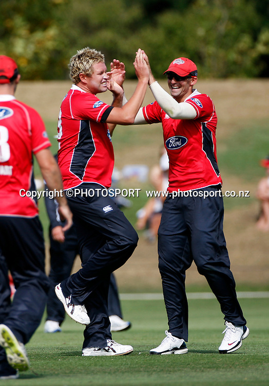 Canterbury pace bowlers Mitchell Claydon and Andrew Ellis celebrate Claydon's wicket of Jeet Raval. Canterbury Wizards v Auckland Aces in the One Day Competition, Preliminary Semi Final. QEII Park, Christchurch, New Zealand. Sunday, 06 February 2011. Joseph Johnson / PHOTOSPORT.