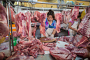 28 MARCH 2012 - HO CHI MINH CITY, VIETNAM:   Meat vendors in the Ben Thanh Market in Ho Chi Minh City, Vietnam. Ben Thanh Market is a large market in the downtown area of Ho Chi Minh City (Saigon), Vietnam in District 1. The market is one of the earliest surviving structures in Saigon and one of the city's landmarks, popular with tourists seeking local handicrafts, textiles,ao dais (Vietnamese traditional dresses), and souvenirs, as well as local cuisine. The market developed from informal markets created by early 17th century street vendors gathering together near the Saigon River. The market was formally established by the French colonial powers in 1859. This market was destroyed by fire in 1870 and rebuilt to become Saigon's largest market. In 1912 the market was moved to a new building and called the New Ben Thanh Market to distinguish over its predecessor. The building was renovated in 1985.    PHOTO BY JACK KURTZ