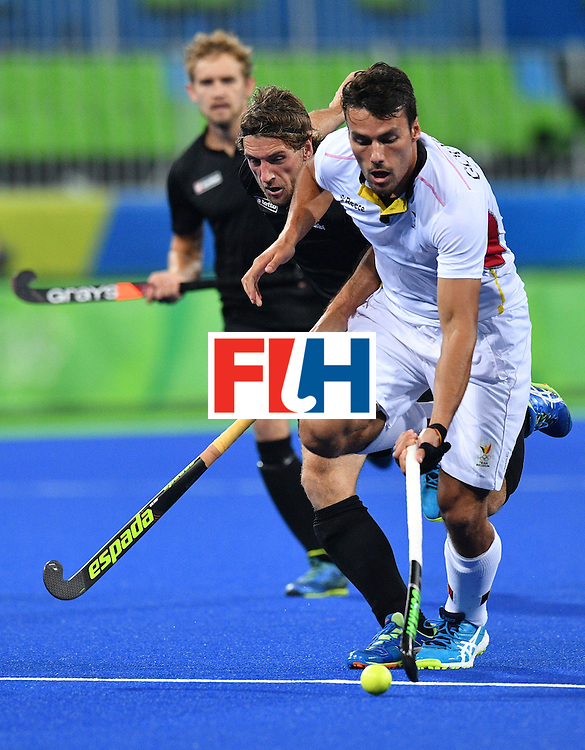 Belgium's Simon Gougnard (R) runs with the ball during the mens's field hockey Belgium vs New Zealand match of the Rio 2016 Olympics Games at the Olympic Hockey Centre in Rio de Janeiro on August, 12 2016. / AFP / Carl DE SOUZA        (Photo credit should read CARL DE SOUZA/AFP/Getty Images)
