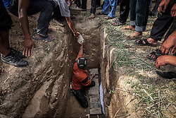 Uzbek men bury a woman killed in the ethnic clashes in Osh, Kyrgyzstan, 15 June 2010. According to media reports 176 people were killed and 1700 wounded during the ethnic clashes in Kyrgyzstan during past days.