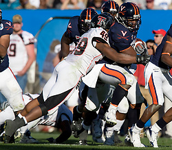 Virginia FB Rashawn Jackson (31) is tackled by Texas Tech safety Joe Garcia (49).  The Texas Tech Red Raiders defeated the Virginia Cavaliers 31-28 in the 2008 Konica Menolta Gator Bowl held at the Jacksonville Municipal Stadium in Jacksonville, FL on January 1, 2008.