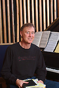 Bruce Hornsby sits at the Piano in his Studio for a Portrait