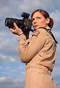 Staff Sgt. Stacy L. Pearsall, Aerial Photographer, Charleston Air Force Base, Charleston, SC, poses for pictures outside of her home unit, 1st Combat Camera, on March 31, 2004. SSgt Pearsall is the Military Photographer of the Year.