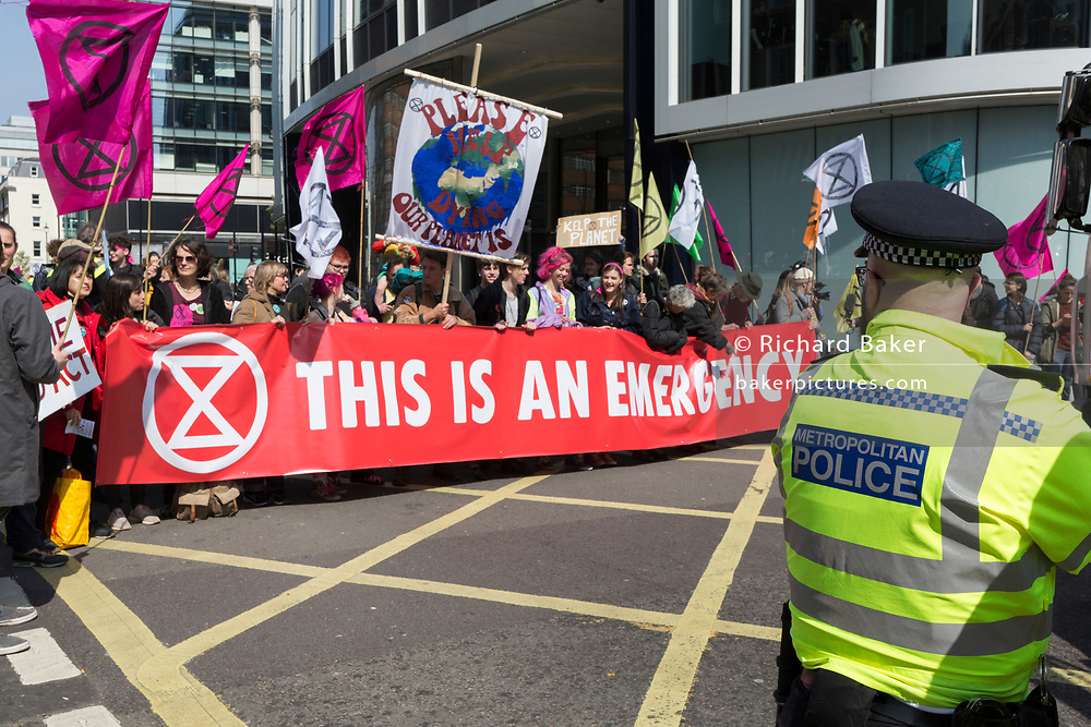 Climate Change protestors with Extinction Rebellion block Oxford Street and simultaneously stop traffic across central London including Marble Arch, Piccadilly Circus, Waterloo Bridge and roads around Parliament Square, on 15th April 2019, in London, England.