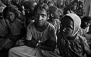 Young girls and women gathered outside a school in Mysore Province, India. (1975)