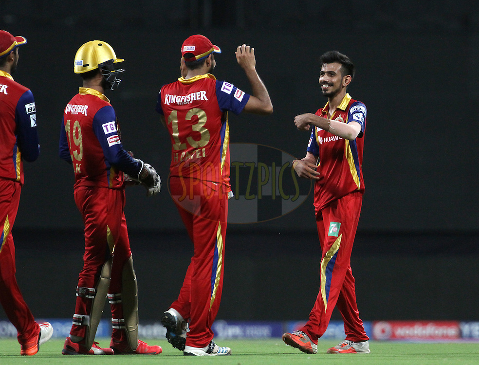 Royal Challengers Bangalore player Yuzvendra Chahal celebrates the wicket of Mumbai Indians player J Suchith during match 46 of the Pepsi IPL 2015 (Indian Premier League) between The Mumbai Indians and The Royal Challengers Bangalore held at the Wankhede Stadium in Mumbai, India on the 10th May 2015.<br /> <br /> Photo by:  Vipin Pawar / SPORTZPICS / IPL