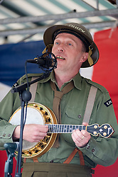 George Fomby impersonator Paul Casper ENSA uniform entertains reenactors and members of the public at Elsecar Heritage centre 1940s Wartime Weekend <br />